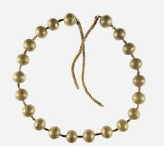 Gold Necklace of the Child Myt, Middle Kingdom, Egypt, circa 2051-2030 BC, early reign of Mentuhotep II, gold, linen, twine