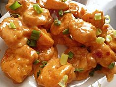 Boom Boom Shrimp! Crispy shrimp get tossed in a creamy, spicy sauce. The result is utterly delicious, and addicting!  Ingredients  	1 pound raw shrimp, peeled and deveined, tails removed (I used