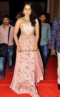 "Rashi khanna lehenga stills at ""Bengal Tiger"" movie audio launch. The Delhi-based heroine grabbed all eyes in Riddhima kollare pink embroidery work lehenga Indian Gowns Dresses, Indian Fashion Dresses, Dress Indian Style, Indian Outfits, Fashion Outfits, Indian Wear, Prom Dresses, Women's Fashion, Dress Neck Designs"