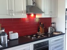 White Kitchen Red Tiles love the black & white tile and red walls. very dramatic