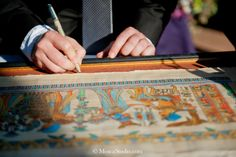 Wedding guest book, ancient Egyptian themed wedding. Our guestbook was a framed papyrus of the Marriage of King Tutankhamun. Guests signed the mat around the papyrus.