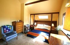Interesting incorporation of the ceiling beam/poster bed feel/built-in nightstands