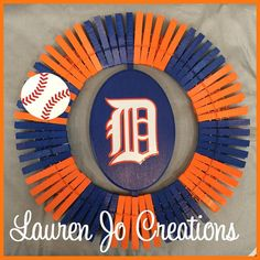 Support your favorite Major League Baseball Team!! The Detroit Tigers!!  Each wreath is custom made; there are no two of a kind! These Detroit Tigers wreaths are made of hand painted wooden clothes pins, wood, and permanent vinyl. You can decorate with this wreath indoors or outdoors. Our wreaths are sprayed with a polyurethane to protect them from outdoor weather. These are very high quality and will last you many seasons.  The wreaths are approximately 14. Please message me with any…