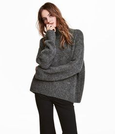 Dark gray. Straight-cut sweater in a soft knit with wool content. Stand-up collar, low dropped shoulders, and long, wide sleeves.