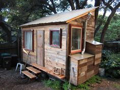 """This tiny home in Oakland, Calif., is made from recycled materials! From the site: """"The Oakland Tiny House is a 120 square foot dwelling on a trailer chassis. The house will feature a full kitchen, composting toilet, outdoor shower, sleeping loft custom built in furniture and a fireplace. The siding is reclaimed redwood fensing and flooring is maple re-purposed from an old roller skating rink in Petaluma."""""""