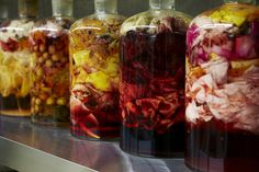 bottled flowers. you know what, i don't even care why.