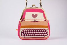 Clutch bag - Typewriter in pink - metal frame purse with shoulder strap -octopurse (etsy)