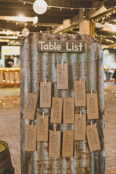 rustic display of the seating arrangements for wedding reception