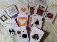 Christmas cards made with old book pages and Harris Tweed