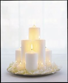 An elegant and easy to make centerpiece with candles. - also tons of other ideas on this site (hydrangeas etc)