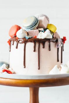A vanilla bean cake with macarons, marshmallows and meringues. - via Fork to Belly