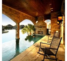 wow... love how the patio leads into the infinity pool with the fireplace...  and the incredible view