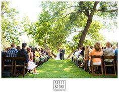 A sunny outdoor wedding ceremony photo | Brett & Tori Photographers