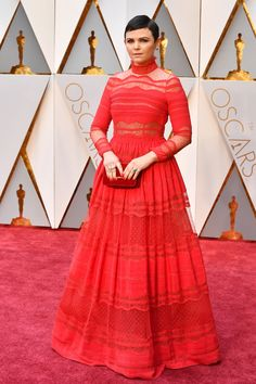 Lady in red! Ginnifer Goodwin matched the red carpet in a long-sleeved, sheer ensemble that she matched with a clutch of the same color. (Photo by Jeff Kravitz/FilmMagic)  via @AOL_Lifestyle Read more: https://www.aol.com/article/entertainment/2017/02/27/biggest-loser-host-bob-harper-suffers-heart-attack/21722974/?a_dgi=aolshare_pinterest#fullscreen