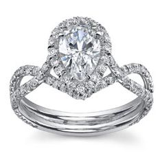 Love the twisted band, setting, and pear shaped diamond!!