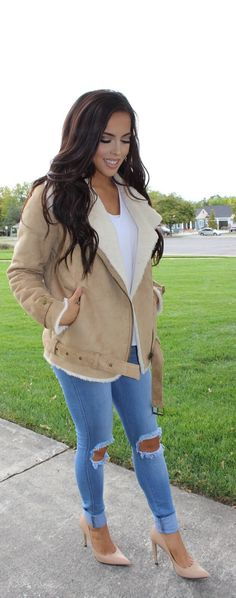 Shearling jacket in tan, simple white tee, blue ripped tough luck  jeans, nude pumps. Forever 21 missguided fashion nova theory