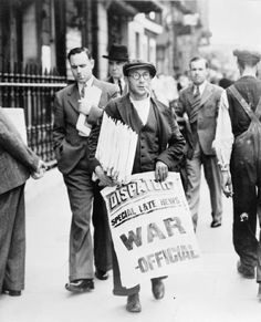 """A newspaper seller carrying a placard announcing that Britain had declared war on Germany."" c. 1939 (via Imperial War Museums)"