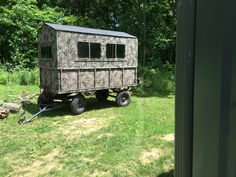 Portable deer blind made from dump wagon with sliding camper windows. All aluminum bed and insulated.