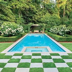 The classic gardens and symmetrical lines of this pool complement one another perfectly.   Image via Southern Living