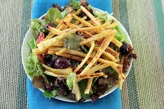 Baked Parsnip Fries Over a Green Salad