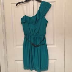 Teal one shoulder dress with belt 👗 Teal one shoulder dress with black bow belt. Great flower deign on bottom and around top. Never worn. Size L. Great condition. Dresses One Shoulder