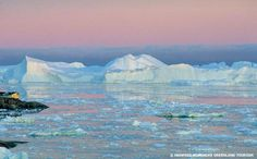 The Ilulissat Icefjord under the glow of the midnight sun in summer.
