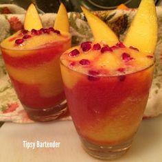 Mango Peach & Pomegranate Cherry Slushie! For the recipe, visit us here: www.TipsyBartender.com