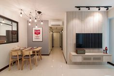 HDB 4-Room Standard Flat. House is designed under Scandinavian theme. Highlight of the house is the clever use of wood and white in the kitchen area. Cosy dining area and wooden featured wall at th…