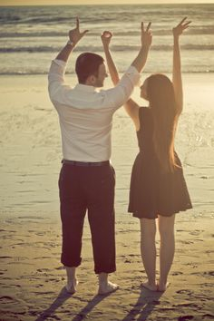 Beach Engagement Shoot by Camarie >> love this picture. adorable pose for a wedding or family, too.