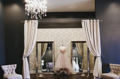 This is a photo of Ivy Bridal Studio in Dublin. This is what I want my master bedroom to look like.  Dark gray paint, my duvet is all white & I want very soft, pale colored (lilac) accents.