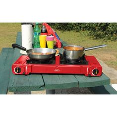 Have to have it. Portable Twin Butane Stove - Red $59.99 - I love butane way more than propane!!!