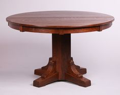 Stickley Brothers Pedestal Dining Table. Signed. Refinished with four new skirted 11″ leaves. 48″d x 29″h. Measures 92″ x 48″ with the leaves.