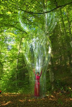 Swiss Artist Muller Encloses Herself in Plastic Bubble Sculptures
