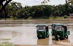 need to wash the CNG autorickshaw, plenty of flood water around..