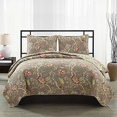 Simple and elegant, complete your bedroom style with the Blythe Floral Quilt Set. Neutral, yet bold the quilt and pillow shams feature a taupe background with an all-over branch and floral print in green, rust and cream. Makes a beautiful statement piece.