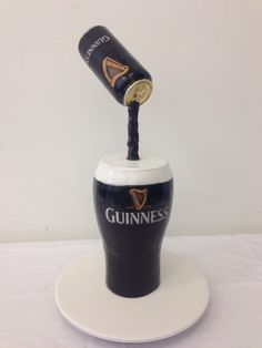 Guinness beer cake with beer can suspended by handi's cakes