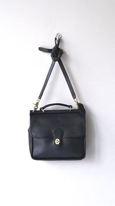 Vintage black leather Coach Willis satchel with long cross body strap, brass hardware, flap closure and large interior compartment. ✂-----Measurements