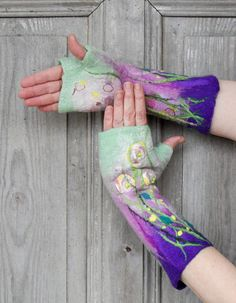 Hand felted long mittens , unique fingerless gloves, decorated with silk fabric flowers, glass beads and natural silk fibers . In felted process I used