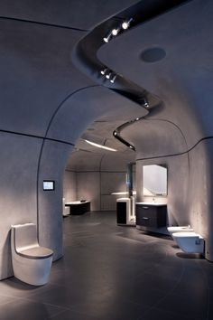 I would be very uncomfortable using this bathroom.   ROCA London Gallery / Zaha Hadid Architects