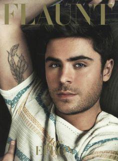 Zac Efron. Feather tattoo. Facial Scruff. He's gorgeous.