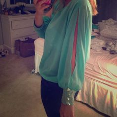 Sheer mint green top with cut out long sleeves Sheer mint green top with cut out long sleeves and sequins around the wrist Hot & Delicious  Tops Blouses