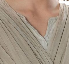 shirt detail. notice the placket neckline