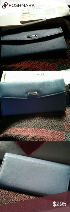 Authentic Fendi wallet. New in box Lovely ladies leather wallet. Authentic Fendi. Baby Blue with red interior. Comes with all cards box and dustbag. Fendi Bags Wallets