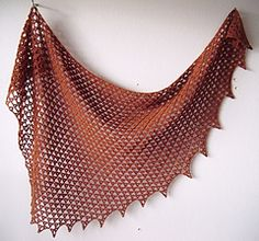 "Restless - Free crochet shawl pattern by Siew Clark. Made in dk yarn, bottom-up, sideways, asymmetrical, semi-circle shawl. The stitch pattern consists of only V-stitches and chains. Measurements: Top edge 66"" x 28"" deep."