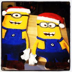 Hand cut and painted Minion plywood Christmas display cut outs