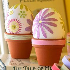 Flower power for your eggs! Prop eggs in a mini terra-cotta pot and decorate with scrapbooking stickers. For more spring table ideas: http://www.midwestliving.com/homes/entertaining/spring-centerpieces/