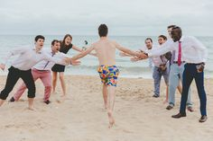 My son, the MC for his sister at her wedding in Bournemouth, having a sneaky swim during the wedding!  Image by Dorset Wedding Photographer Paul Underhill - DIY Wedding On The Dorset Coast