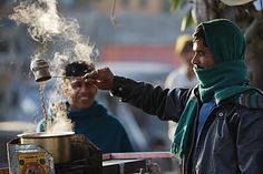 A man is 'cooking' Indian tea on a cold morning near Jaipur. This 'Indian Cha-i(tea)' is made with tea leaf, milk, ginger and certain spice . Indian Milk, Pouring Coffee, Appreciate Life, Masala Chai, Visit India, Tea Art, Milk Tea, Outdoor Life, Incredible India