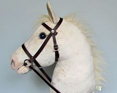 Cremello hobby horsing horse with open mouth. Blue eyes and shaded pink muzzle. Horse Bridle, Horse Stables, Dapple Grey Horses, Stick Horses, Oldest Child, Horse Crafts, Hobby Horse, Horse Riding, Horses