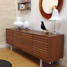 Punt Sussex sideboard in Walnut finish. Ex display and in excellent condition, the Sussex sideboard has three door units (with one internal shelf in each unit) and one three drawers unit. Now £2,150.00.